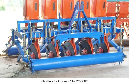 Disk plow, part of the cultivator, steel row discs in a row.Tracktor disc harrow trailer for farming machine. The work of agricultural machinery