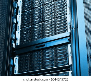 disk storage as the background of close-up hard drives in data center room