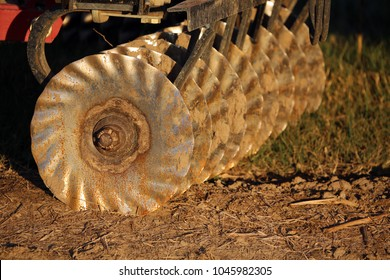 Disking blades for flattening and loosing up farm fields for planting, Calvert County, Maryland, USA