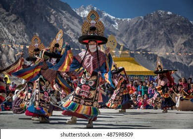 DISKIT, LADAKH, INDIA - OCTOBER 11, 2015: Buddhist Tibetan monks are dancing ritual mask dance, cham in the annual religious festival in Diskit monastery in Nubra valley in the Indian Himalaya.