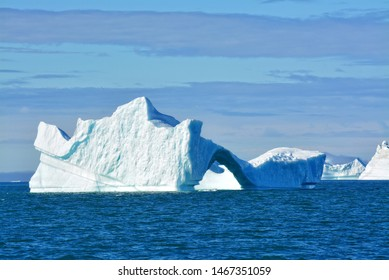 Disko Bay, Greenland - July - boat trip in the morning over the arctic sea - Baffin Bay - cold and fresh air and big beautiful icebergs, quiet moments in a wonderful nature