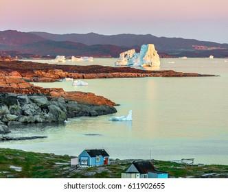 Disko bay, West Greenland. Night view of the village Oqaatsut