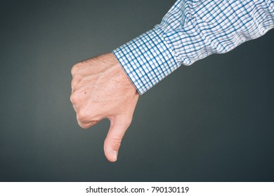 Dislike and disapprove hand gesture with thumb down, businessman is rejecting project