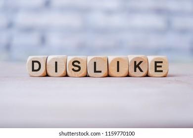 Dislike word written on wood block