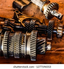 Dismantled box car transmissions. The gears on the shaft of a mechanical transmission.