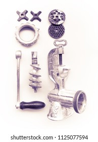 dismantled old manual meat-grinder