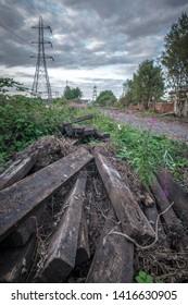 Dismantled sleepers lying next to former railway tracks, Ocker Hill, West Midlands.