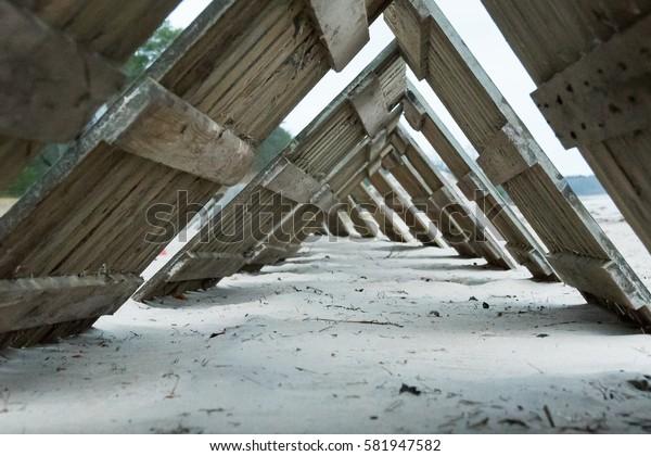 Dismantled tracks on a sandy beach