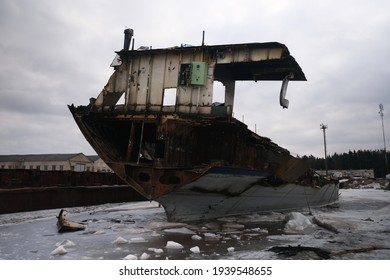 dismantling of old rusty ships in the winter.