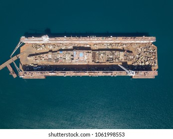 dismantling of a ship in a dock, top view