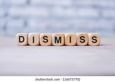 Dismiss word written on wood block