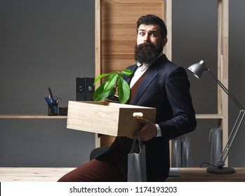 Dismissed employee in suit with belongings. Getting fired. Last day at work. Upset office worker is fired. Reduction of personnel. Losing job. Sad fired businessman leaving office. Restructuring.