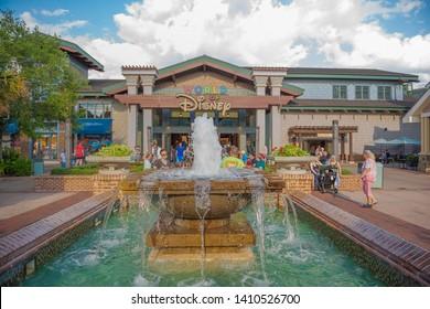 Disney Springs water fall Orlando Florida March 24, 2019 people walking around World of Disney Store
