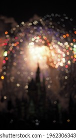 Disney World castle at night during the stunning firework session in bokeh