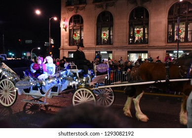 Disney's Frozen Elsa and Anna in a horse drawn carriage in the Festival of Lights Parade, Chicago, IL November 17, 2018