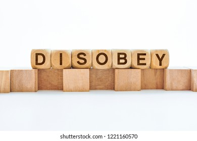 Disobey word on wooden cubes
