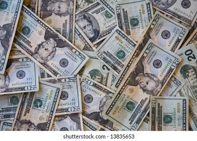 A disorderly pile of united states twenty dollar bills