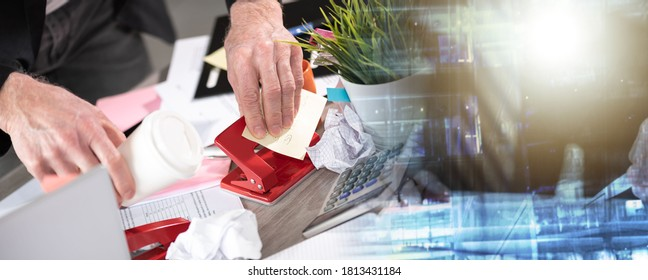Disorganized businessman looking for documents on his messy desk; multiple exposure