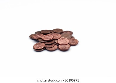 Disorganized pile of one cent coins on white isolating background