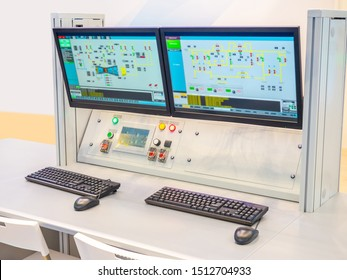 Dispatch center. Control Center at the factory. Screens in the office of the dispatcher. Plant management system. Place of business management. Workplace dispatcher. Hardware and software system.