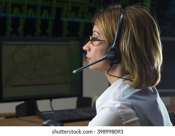Dispatcher with headphone in power distribution control center