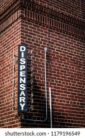 A dispensary sign on a brick medical building in Philadelphia, PA.