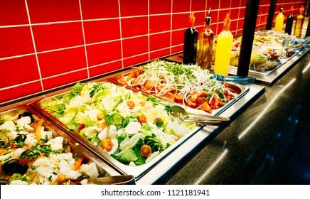 dispenser of fresh salads in restaurant