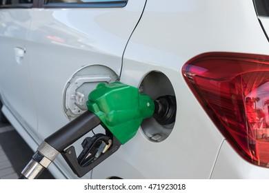 Dispenser pumping diesel or gasoline in car at gas station