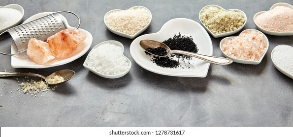 Display of assorted fresh natural culinary salt in a panorama banner with copy space including black Hawaiian lava salt, Indus, Fleur de sel, Flor da Sal,