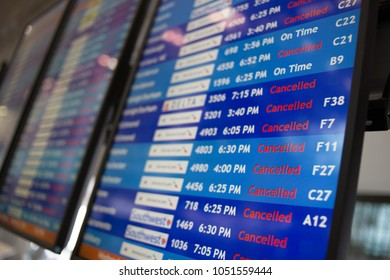 A display board at Philadelphia International Airport shows mostly canceled flights during a Nor'easter that brought heavy snow, Wednesday, March 21, 2018.