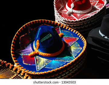 A display of bright colored Mexican hats.
