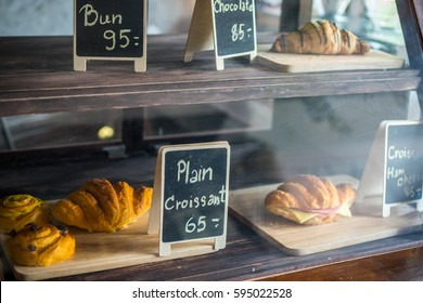Display cabinets, breads and Croissant with a tag price.