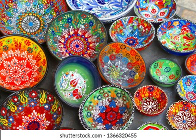 Display of ceramic bowls with dots and colorful abstract patterns in arts and crafts store, Middle East