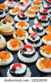 Display of colorful individual gourmet appetizers on a buffet table at a banquet or upmarket catered event