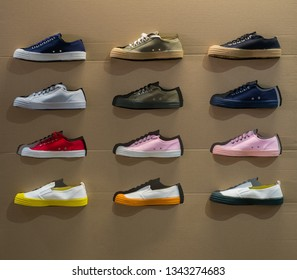 Display with different colourful sport shoes. Athletic and fashion concept.