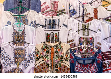 Display of embroidered Ukrainian slavic women and men traditional shirts embroidery clothing in outdoor flea market in Lviv, Ukraine. Ethnic texture design on the cloth. Close up