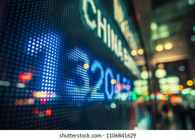 Display of Financial Stock market quotes with city scene reflect on glass