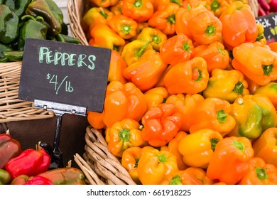 Display of fresh orange peppers at the farmers market