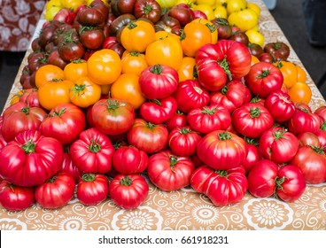 Display of fresh red ripe tomatoes at the farmers market