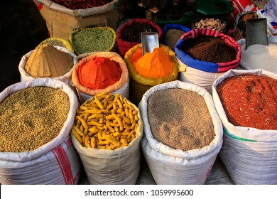 Display of grain and spices at the street market in Fatehpur Sikri, Uttar Pradesh, India.