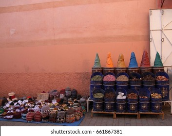 A display of herbs, dried flowers and skull hats plus other apothecary items in a laneway leading into the old town of Marrakech, Morocco.