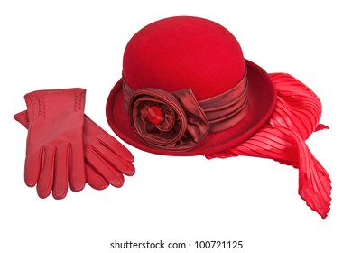 Display of a ladies red felt hat with ribbon and leather gloves.
