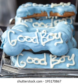 Display of lovely high quality decorative dog treats in bone shape with blue icing and the words Good Boy in white