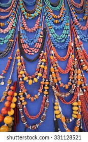 A display of Moroccan and African jewelry and daggers for sale in the souks of Marrakesh, Morocco.