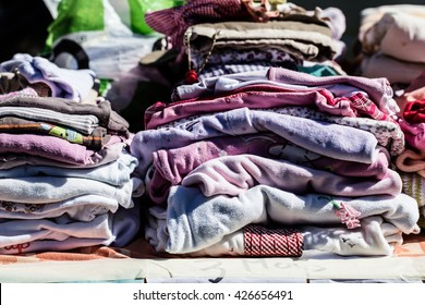 display of second hand baby clothes and pajamas for reusing, reselling,recycling,donating or welfare for second life sold at thrift store