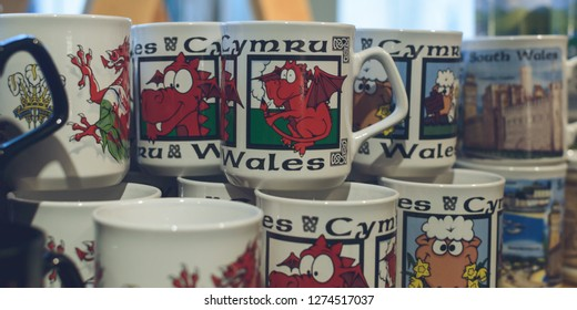 Display of souvenir mugs with Welsh Dragon, shallow depth of field, Wales Cardiff 2019