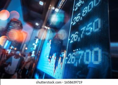 Display stock market numbers with defocused street lights background