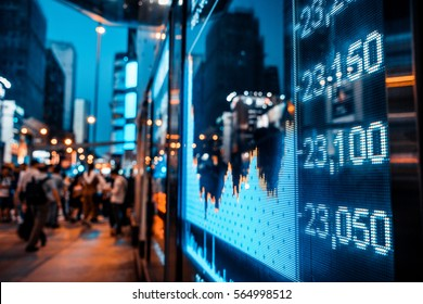Display of Stock market quotes with city scene reflect on glass - Shutterstock ID 564998512
