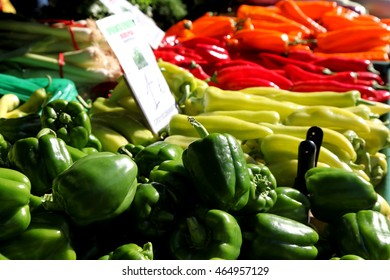 A display of sweet peppers on a mediterranean farm market stall