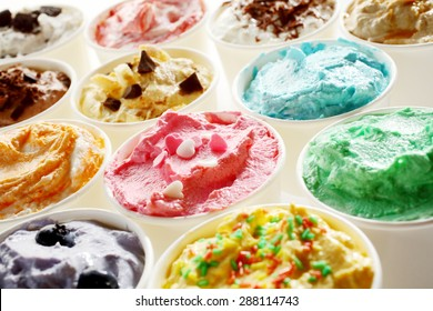 Display of tasty summer ice cream in different flavors and colors served in individual tubs viewed obliquely for advertising for a parlour or ice cream shop - Shutterstock ID 288114743